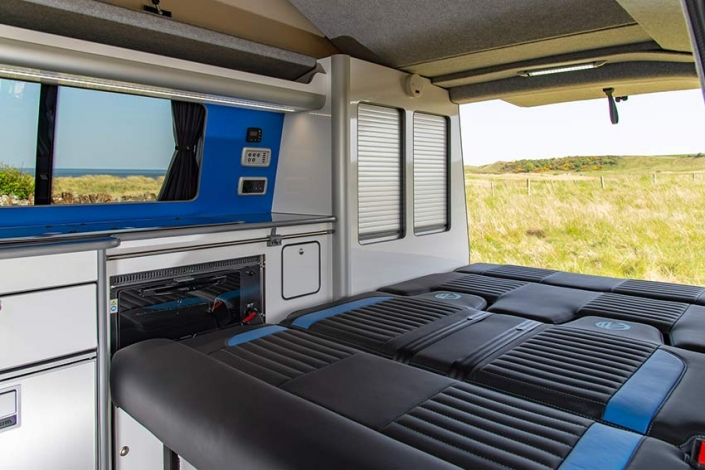 Our VW transporter campervan bed and kitchen